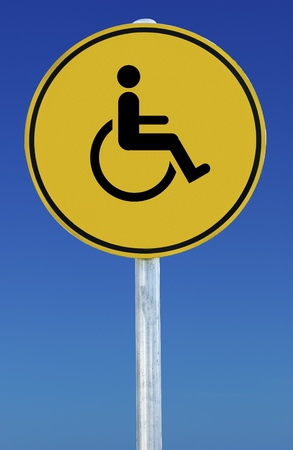 Wheelchair picture on a yellow sign isolated on a blue graduated sky.