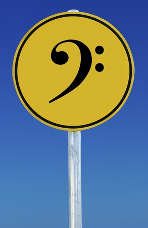 bass clef: Bass Clef sign isolated on a blue graduated sky. Stock Photo