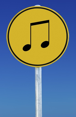 A Musical note sign isolated on a blue graduated sky. photo