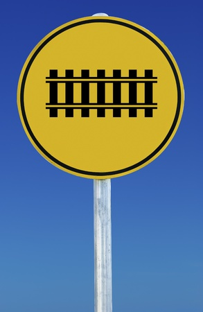 A train tracks road sign isolated on a blue graduated sky. photo