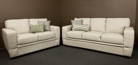 Comfortable new white lounge setting. A 2 and a 3 seater lounge. Stock Photo - 9138940