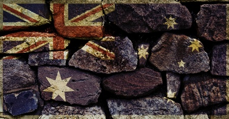 The Australian Flag graffitied on to a stone wall.