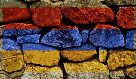 The Armenian Flag painted on to a stone wall. photo