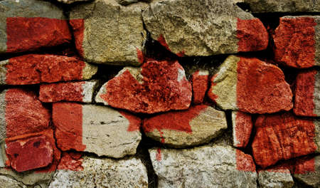 The Canadian Flag painted on to a stone wall. Stock Photo - 9257653