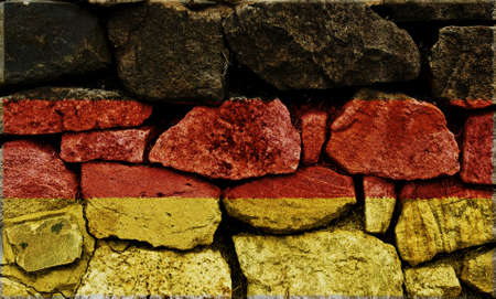 The German Flag painted on to a stone wall. Stock Photo - 9257648