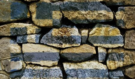 The Greek Flag painted on to a stone wall. photo
