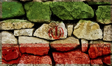 The Iranian Flag painted on to a stone wall. Stock Photo