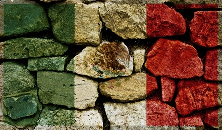 The Mexican Flag painted on to a stone wall.