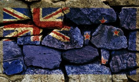 The New Zealand Flag painted on to a stone wall. photo