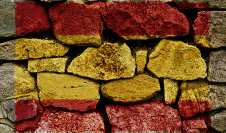 The Spanish Flag painted on to a stone wall. Stock Photo - 9257654