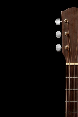 Guitar neck and tuning end isolated on black with room for copy. Stock Photo
