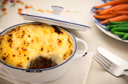 Homemade shepard pie with beef topped with golden mashed potato photo