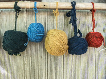 wools: Naturally dyed balls of yarn in white, red, blue, yellow and green Stock Photo