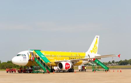 waited: Ubonratchathani, Thailand - June 5 2015: Thai Airasia plane loading baggage and waited fly at Ubonratchathani airport.