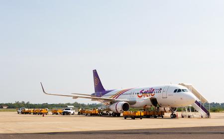 waited: Ubonratchathani, Thailand - June 5 2015: Thai Smile plane loading baggage and waited fly at Ubonratchathani airport.