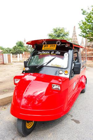 auto rickshaw: Ayutthaya Thailand - July 30 2015: Red Auto rickshaw, Motorized tricycle park to waiting travelers at Wat Chaiwatthanaram.
