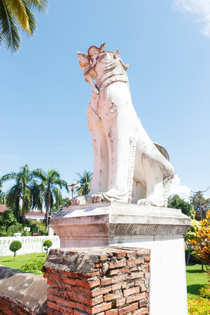 White lion sculpture in front of Wat Phumin Nan, Thailand Side view Editorial