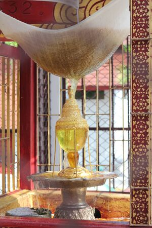 relics: Sprinkle water onto a Sarira of Buddhist relics at Wat Phrathat srichomthong, Chiangmai, Thailand.