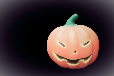 hollows: Scary smile of Halloween pumpkin on black background, Isolated.