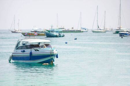 phi phi: Speed boat and sailboats at Phi Phi island in Krabi, Thailand. Selective focus. Stock Photo