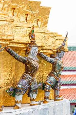 in wat phra kaew: Giant demon statue on golden pagoda at Wat Phra Kaew, Bangkok, Thailand. Stock Photo