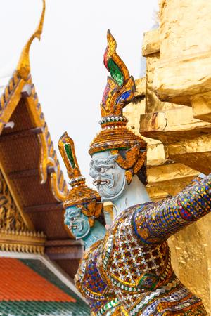 Wat Phra Kaew: Giant demon statue on golden pagoda at Wat Phra Kaew, Bangkok, Thailand. Stock Photo