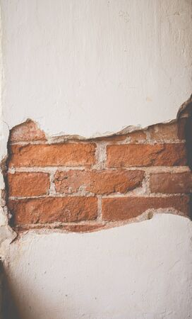 cracked cement: Cracked cement see the inside brick of wall, Vintage style.