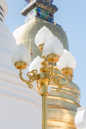 stupa one: Golden street lamp in thai temple.
