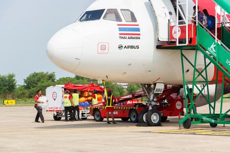 waited: Ubonratchathani, Thailand - June 7 2015: Thai Airasia plane loading baggage and waited fly at Ubonratchathani airport.