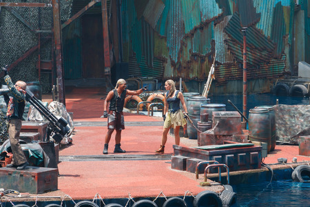 speed gun: Sentosa, Singapore - April 13, 2015: Actors are shown fighting and adventure of WaterWorld show at Universal Studios.