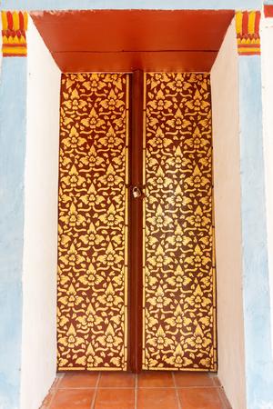 scripture: Golden door of scripture hall of Buddha temple.