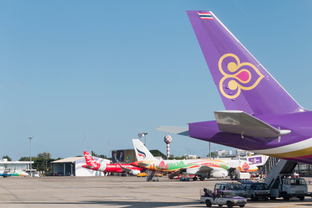 waited: Chiangmai, Thailand - December 5 2015: Thai Airways and Bangkok Airways and Thai Air Asia plane loading baggage and waited fly at Chiangmai airport.