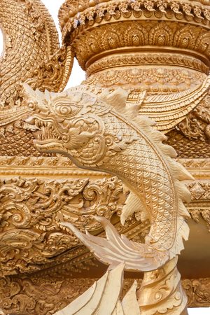 asian art: Golden fish statue, traditional Thai style about Buddhist story, Stock Photo