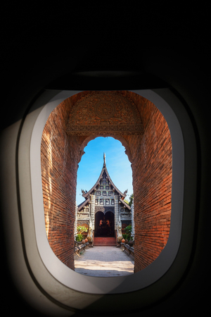Aerial view of airplane window, Brick tunnel gate of Wat Lok molee in Chiangmai, Thailand. Stock Photo