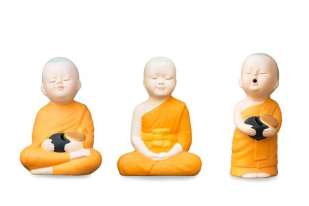Group of young Buddhist monk statue on white background, Isolated. 写真素材