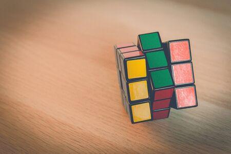 Bangkok, Thailand - January 17, 2018: Rubiks 3x3 cube on wooden background, vintage style.