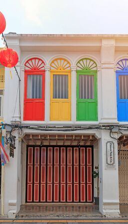 Phuket, Thailand - February 26, 2017: Old multicolor building Sino-Portuguese architecture style in city. Reklamní fotografie - 136694814