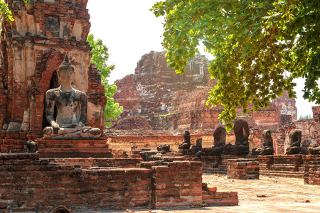 Old Buddha statue in at Wat Maha That, Phra Nakhon Si Ayutthaya Province, Thailand.