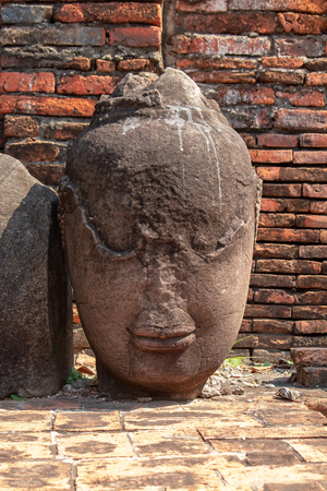 Old head Buddha statue in at Wat Maha That, Phra Nakhon Si Ayutthaya Province, Thailand.