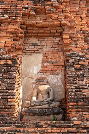 Old Buddha statue in at Wat Maha That, Phra Nakhon Si Ayutthaya Province, Thailand.