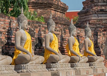 Row of white Buddha statue at Wat Yai Chaimongkol, Ayutthaya, Thailand.