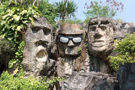 Pathumthani, THAILAND - December 11, 2017 : Three stone heads in Dream world, amusement park in Thailand.