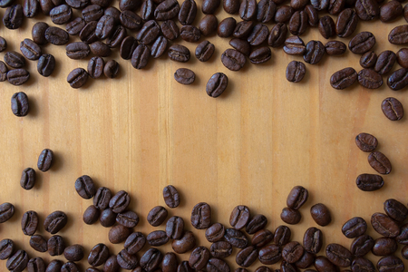 Roasted coffee beans with copy space background. Reklamní fotografie