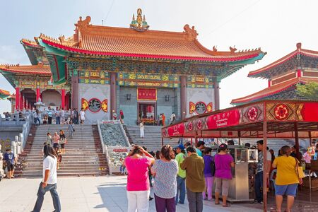 Nonthaburi, Thailand - January 1, 2013: Tourists to visit and pray for good luck on New year at Wat Mangkon Kamalawat, Chinese temple.