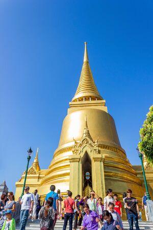 Bangkok, Thailand - December 31, 2014: Tourists visit Wat Phra Kaew to pray for God and take a photos.