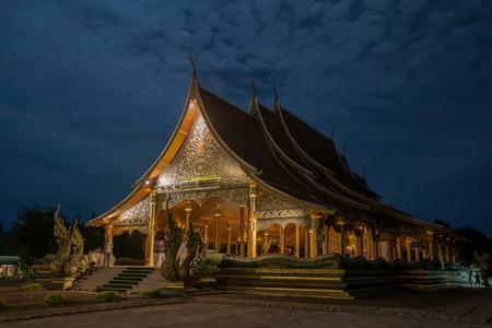 Golden Buddha statue  at Wat Phu Prao, Sirindhorn Wararam Temple in Ubon Ratchathani, Thailand. Redakční