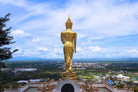 Big golden Buddha statue in Wat Phra That Khao Noi.