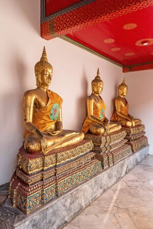 Roll of Golden Buddha in Wat Pho temple in Bangkok Thailand.