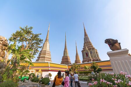 Bangkok, Thailand - December 5, 2019: Tourists travel to visit at Wat Pho Buddhist temple.