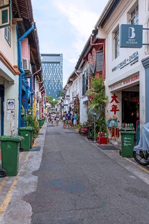Kampong Glam, Singapore - April 11, 2015: Tourists walk to shopping on Haji lane.